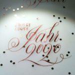 Englische Schreibschrift geschrieben mit Spitzfeder und Fintec-Farbe in Bronze.